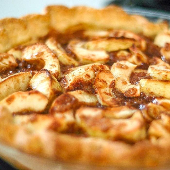 Toffee Apple Tart close up photo of uncut tart