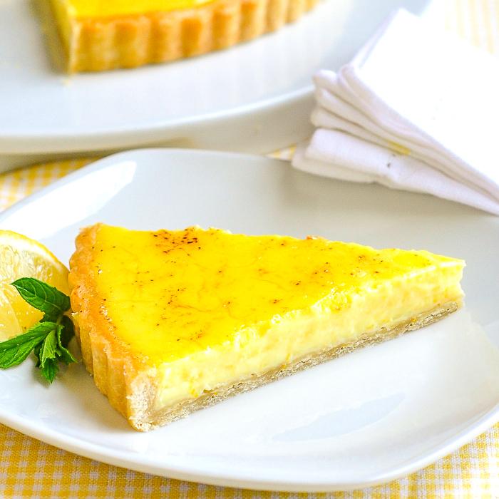 Close up photo of one slice pf classic lemon tart