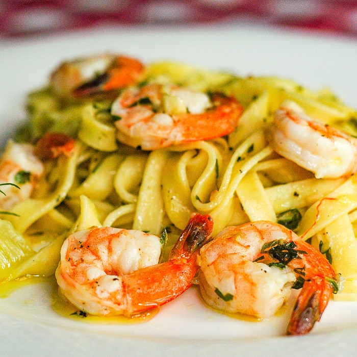 Super Simple Shrimp Scampi close up photo of a single serving on a white plate