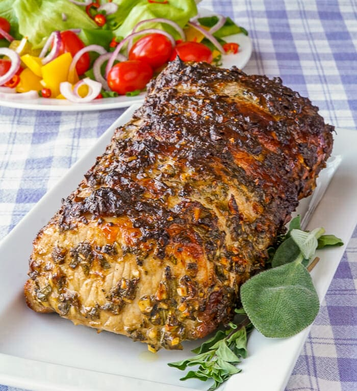 Herb Crusted Pork Loin on serving platter