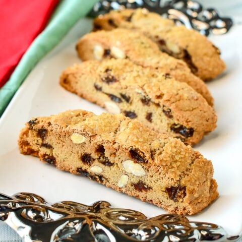 Almond Raisin Biscotti shown served on a small white and silver platter