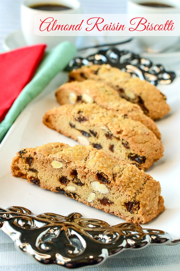 Almond Raisin Biscotti shown served on a white and silver platter with title text added for Pinterest