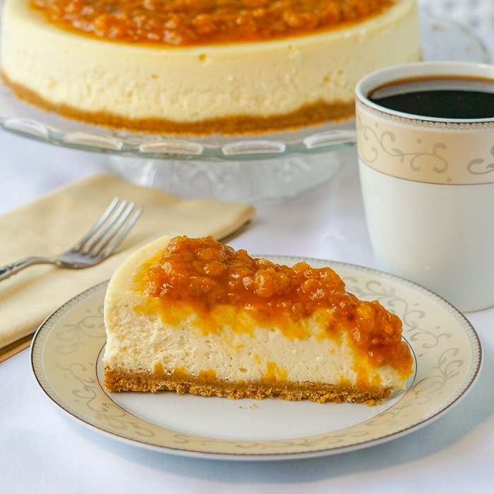 Bakeapple Cheesecake photo of slice on a serving plate with coffee