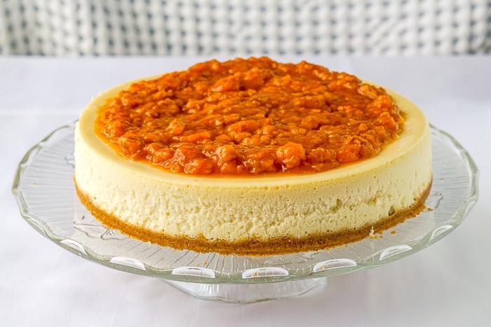 Bakeapple Cheesecake wide shot full cheesecake on glass plate