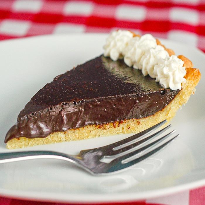 Tarte au Chocolat photo of one slice on a white plate