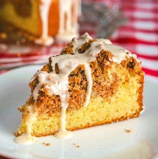 Pecan Streusel Coffee Cake close up photo of single slice on white plate