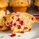 Cranberry Orange Muffins close up showing inside cut of a single muffin