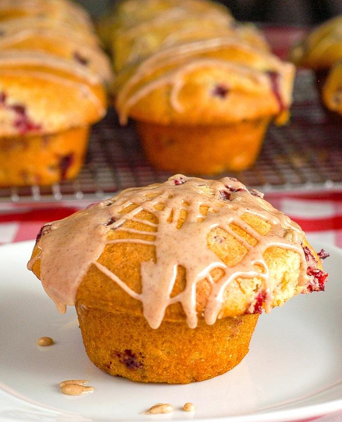Cranberry Orange Muffins on white pla