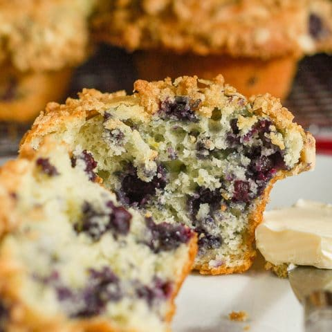 Lemon Blueberry Muffins with oatmeal almond streusel cut in half to show interior crumb structure