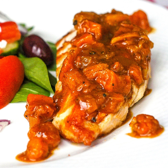Bakeapple Peach Ginger Chutney close up featured image on grilled chicken