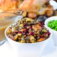 Herb Cranberry stuffing in a white serving bowlHerb Cranverry stuffing in a white serving bowl