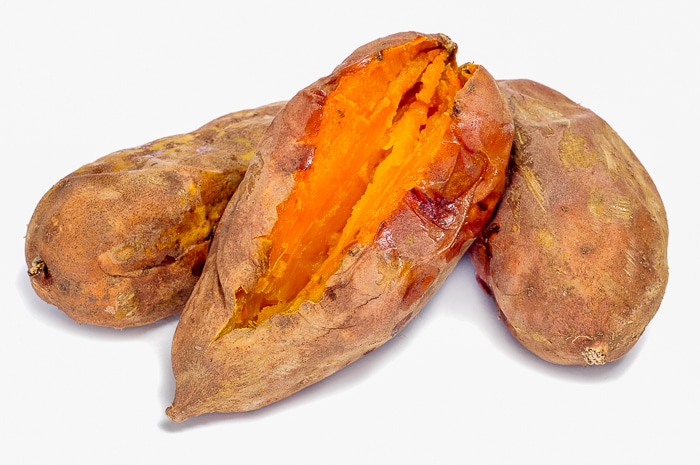 some roasted sweet potatoes on a white background