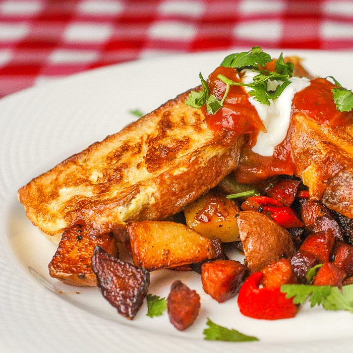Chorizo Hash Browns with Spicy French Toast close up photo on white plate