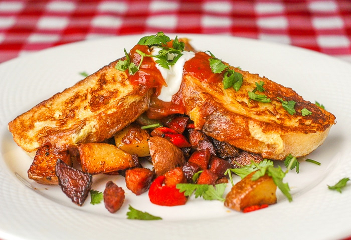 Chorizo Hash Browns with Spicy French Toast wide shot phot of sa serving on a white plate