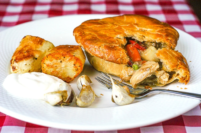 Turkey Pot Pie broken open to show veggies, gravy and turkey inside