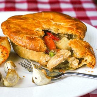 Turkey Pot Pie square croped featured image of pie cut open to reveal filling