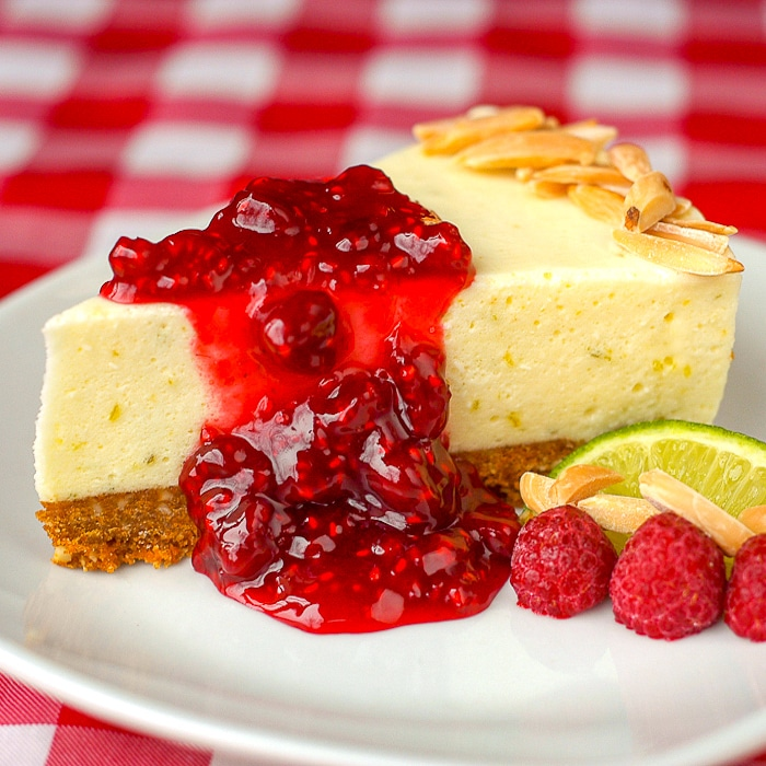 Lime Cheesecake Chiffon Pie with raspberries and lime slice for garnish