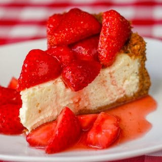 Strawberry Cointreau Sour Cream Custard Flan photo of single slice on a white plate