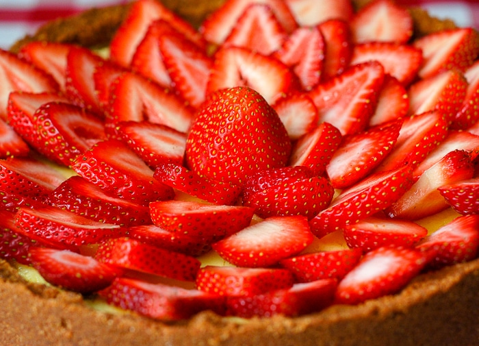 Strawberry Cointreau Sour Cream Custard Flan close up shot of completed flan garnished with strawberries