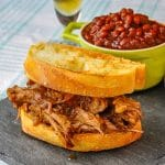 Apple Barbecue Pulled Pork Sandwich shown with homemade baked beans