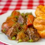 Burgundy Beef Stew close up photo of a serving on white plate