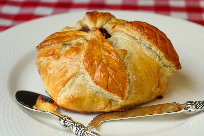 Baked Brie in Puff Pastry with Cranberries Pistachios and Honey.