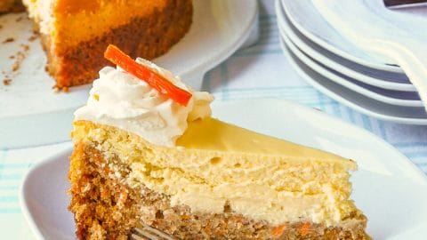Carrot Cake Cheesecake photo of a single slice on a white plate