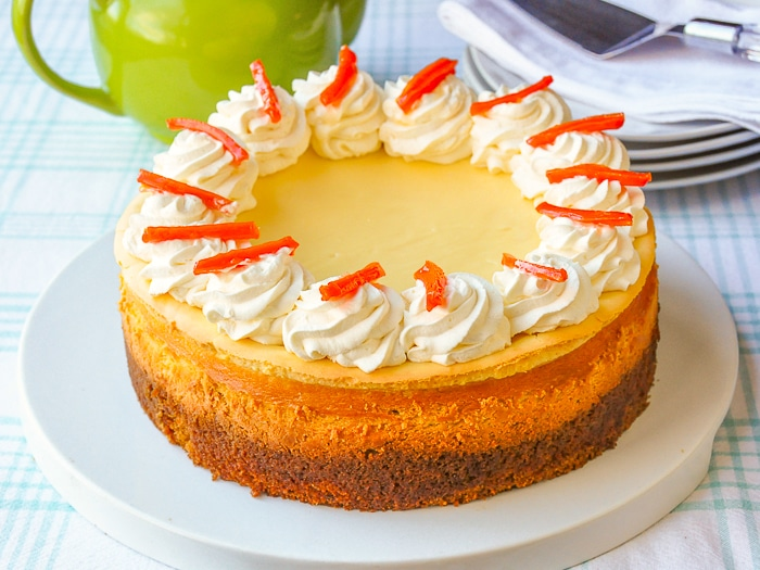 Carrot Cake Cheesecake photo of entire finished cheesecake on a white cake platter