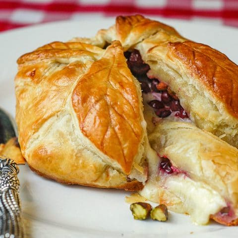 Brie with Partridgeberries, Pistachios, and Honey in Puff Pastry