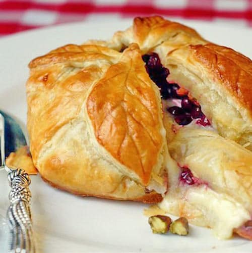 Baked Brie in Puff Pastry with Cranberries Pistachios and Honey