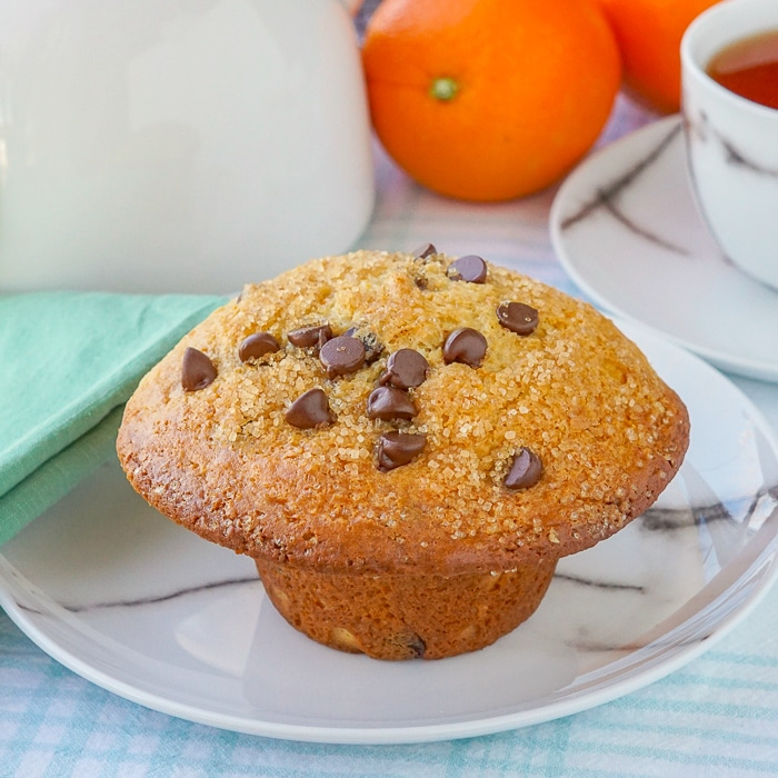Chocolate Orange Muffins featured image close up of one muffin on a marble pattern plate