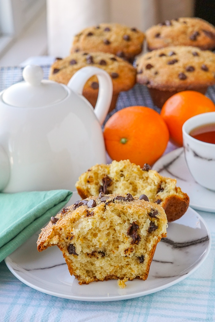 Chocolate Orange Muffins one muffin split open on a marble pattern plate