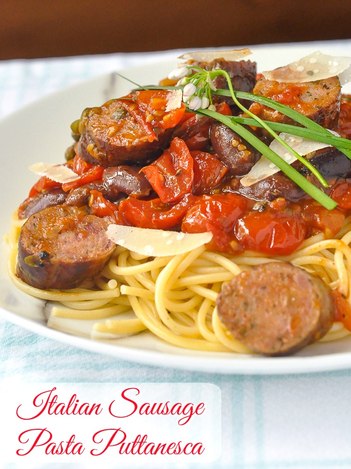 Italian Sausage Pasta Puttanesca photo of a single serving with title text added for Pinterest