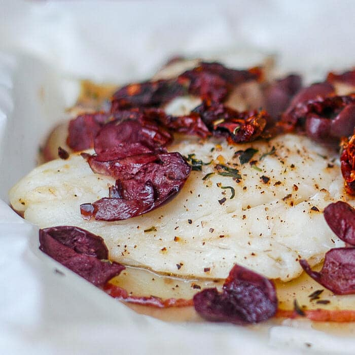 Newfoundland Cod with Olives and Sundried Tomatoes en Papillote close up