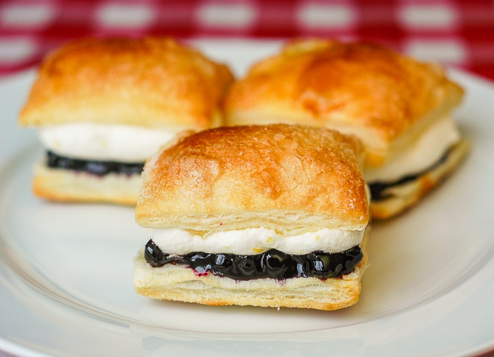 Blueberry Lemon Mini Puff Pastries on a white serving plate