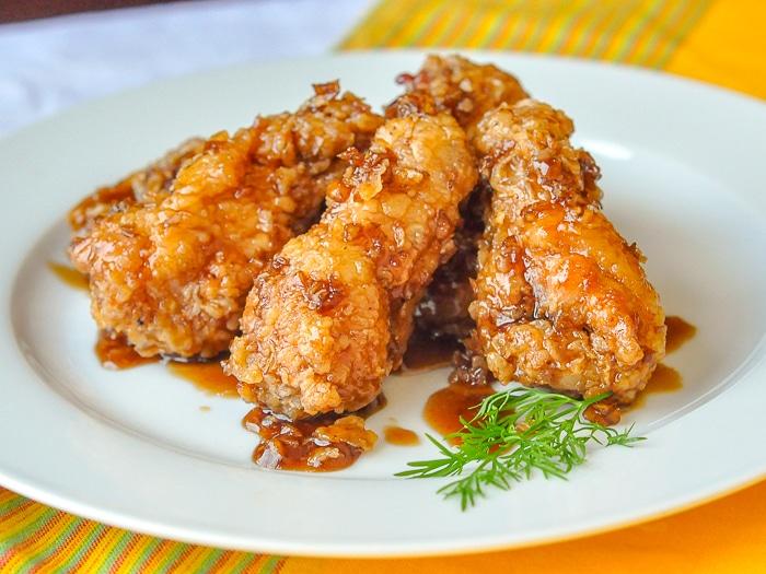 Crispy Honey Garlic Chicken Wings on a white plate