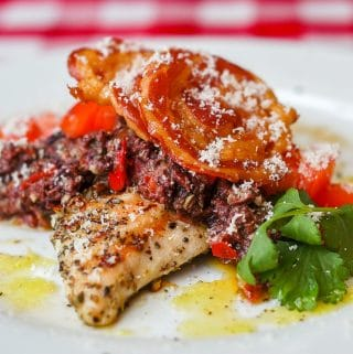 Garlic Oregano Chicken with Red Pepper Parmesan Tapenade and Crispy Pancetta, close up photo