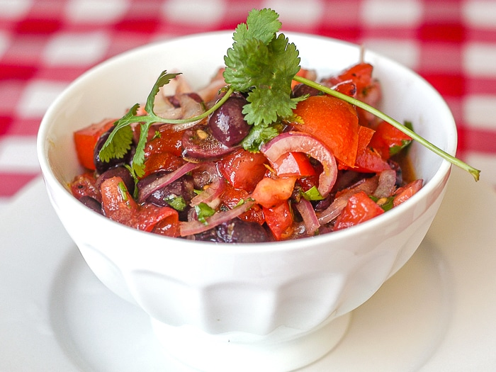 Tomato Olive Salad in a white bowl