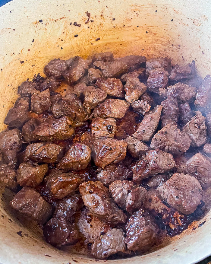 Brown the beef or lamb very well in single layers so that you do not crowd the pan