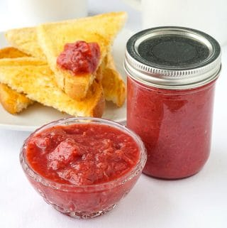 Heavenly Rhubarb Jam in a small serving dish with full mason jar on the side