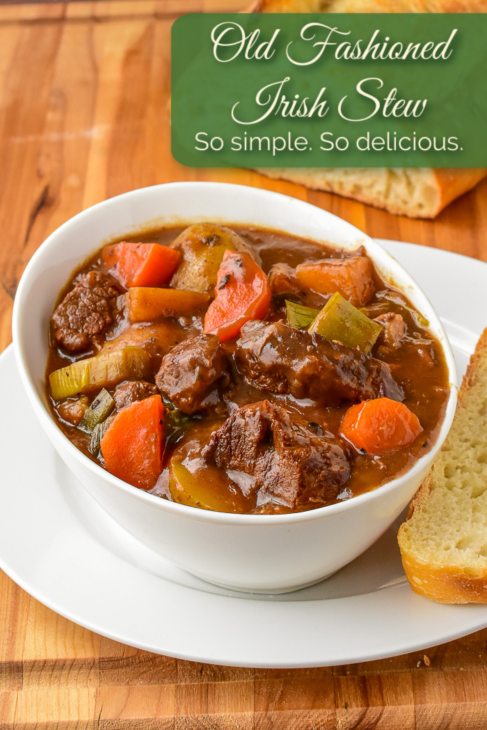 Irish Stew shown with sourdough bread and title text added for Pinterest