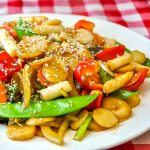 Stir Fried vegetables in Black Bean Ginger Sauce close up photo garnished with sesame seeds.