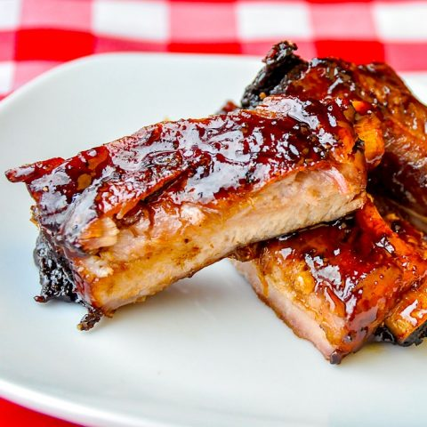 Black Bean Ginger Glazed Ribs close up photo on white plate