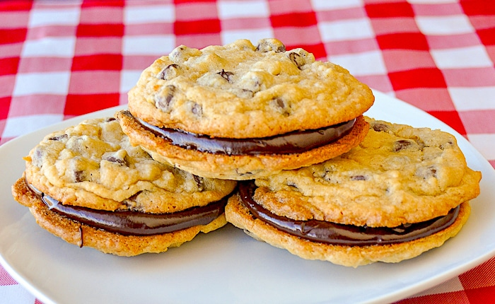 Chocolate Chip Coconut Sandwich Cookies stacked on a white plate