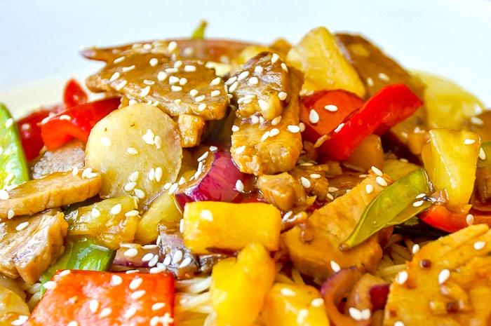 Easy Stir Fried Pineapple Pork close up image garnished with sesame seeds