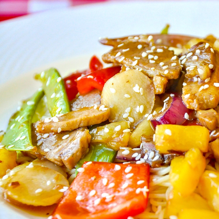 Easy Stir Fried Pineapple Pork featured square image on white plate served with noodles