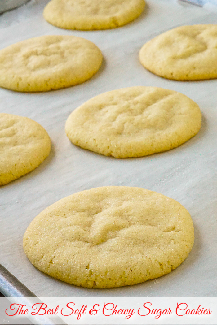 Photo of Soft and Chewy Sugar Cookies fresh from the oven with title text added for Pinterest