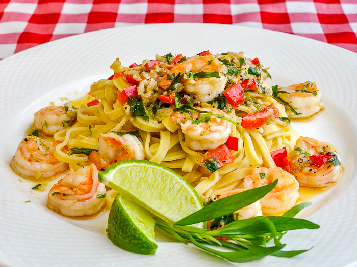 Tarragon Lime Shrimp Scampi photo of a single serving garnished with lime and tarragon