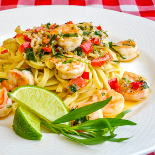 Tarragon Lime Shrimp Scampi pictured on a white plate