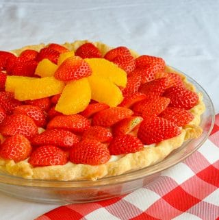 White Chocolate Mousse Pie with Orange and Strawberry close up photo of uncut pie
